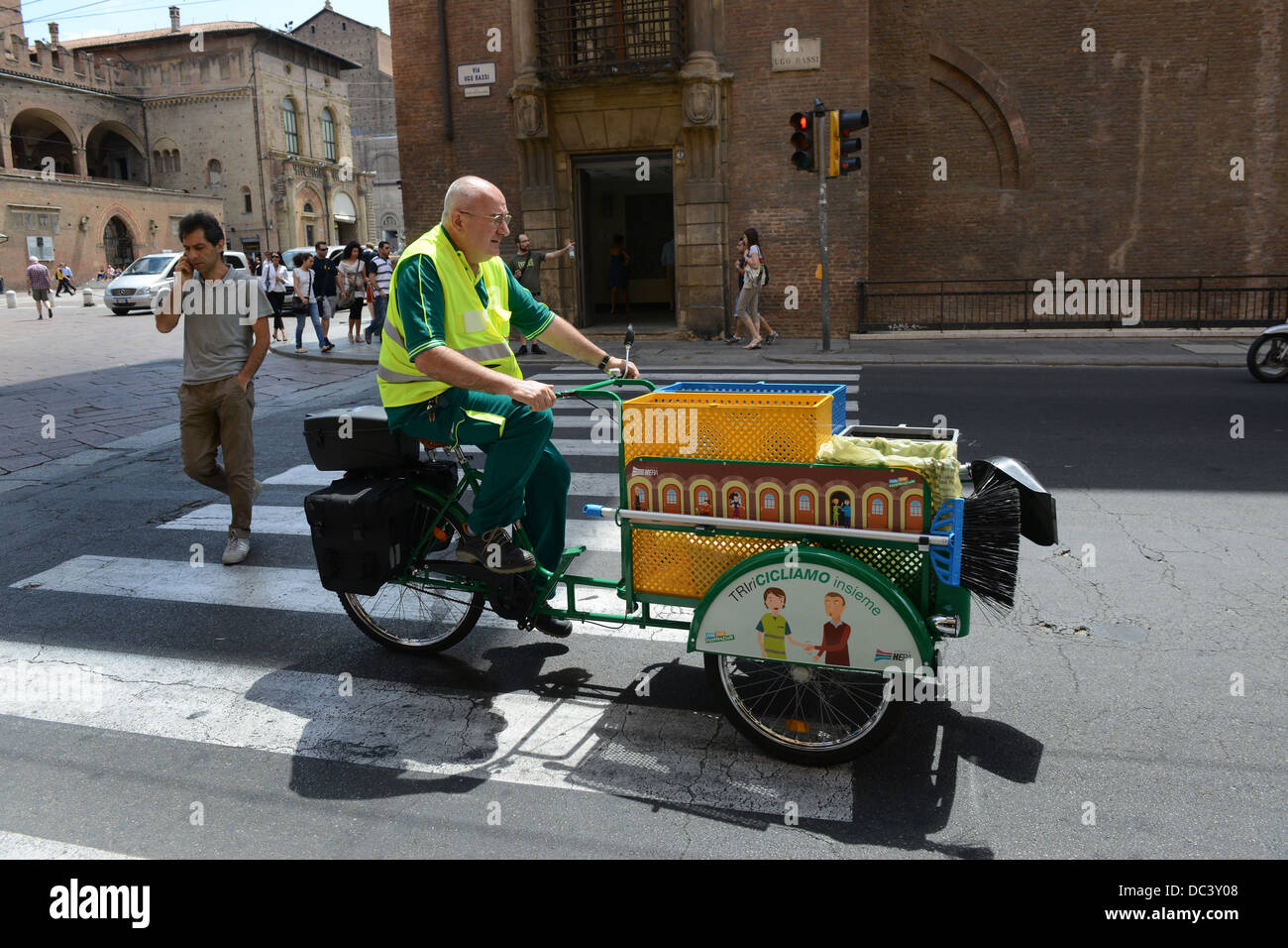 Bologna Italy street cleaner on pedal bike cart Stock Photo