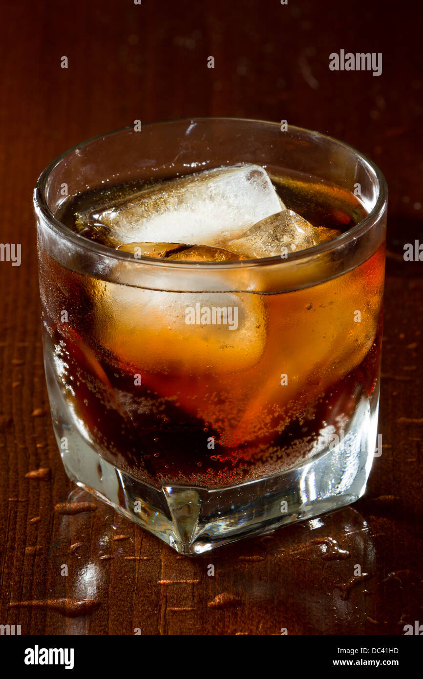cuba libre, rum and cola cocktail served in a short glass - Stock Image