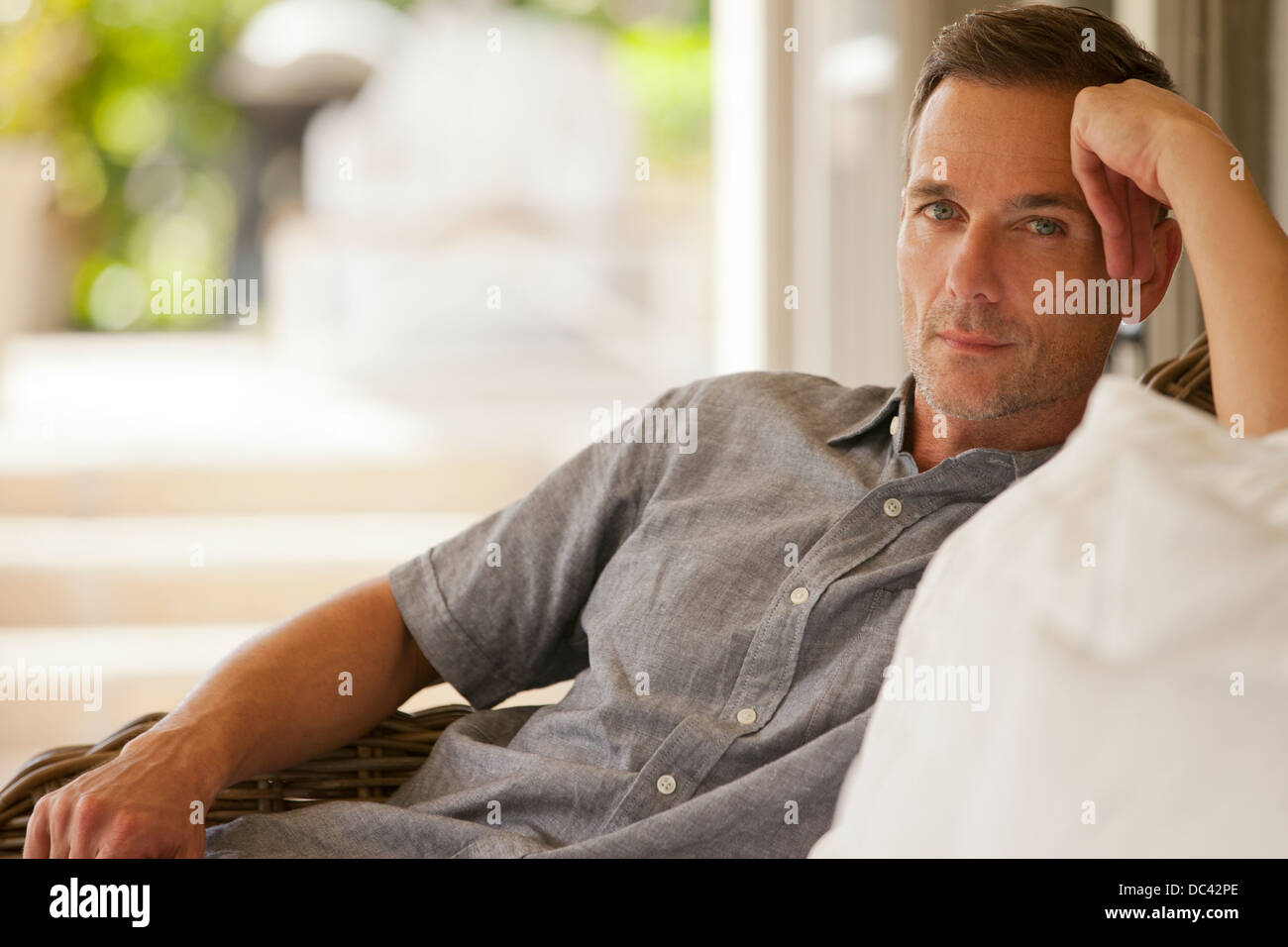 Portrait of serious man on porch - Stock Image