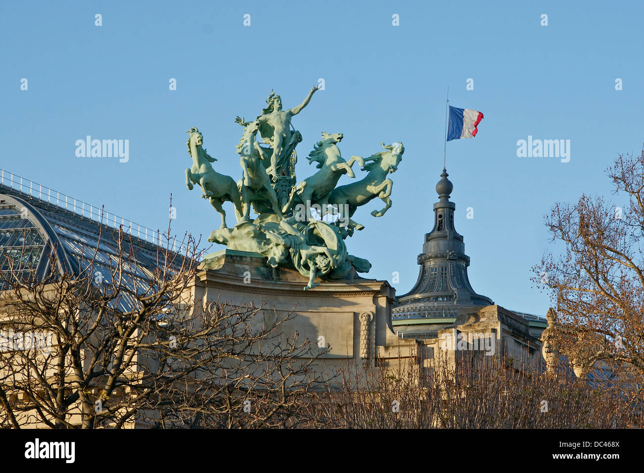 A part of the roof of the Grand Palais (side near the Seine), showing the bronze group Harmony triumphing over Discord, - Stock Image