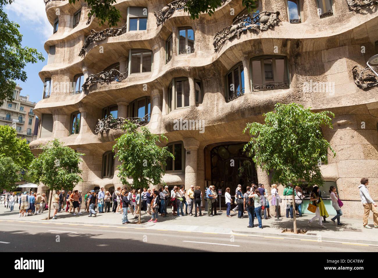 visitors queuing outside La Pedrera in Barcelona - Stock Image