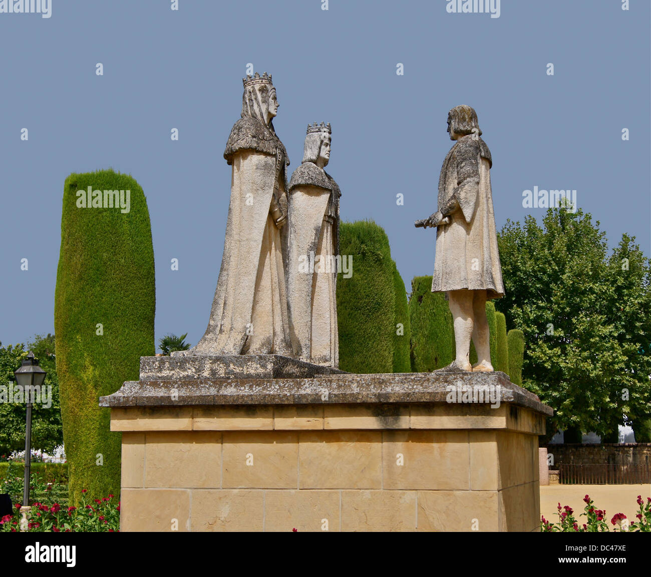 Isabel of Castile, Fernando of Aragon, and Christopher Columbus, statues in the garden of the Alcazar of Cordoba, - Stock Image