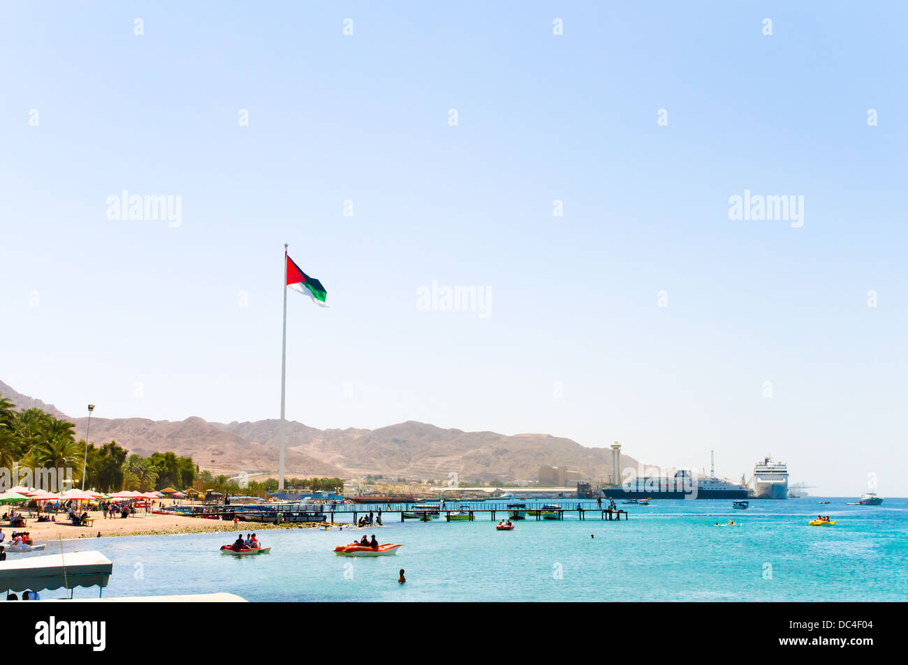 Huge flag on the public beach of Aqaba, Jordan - Stock Image