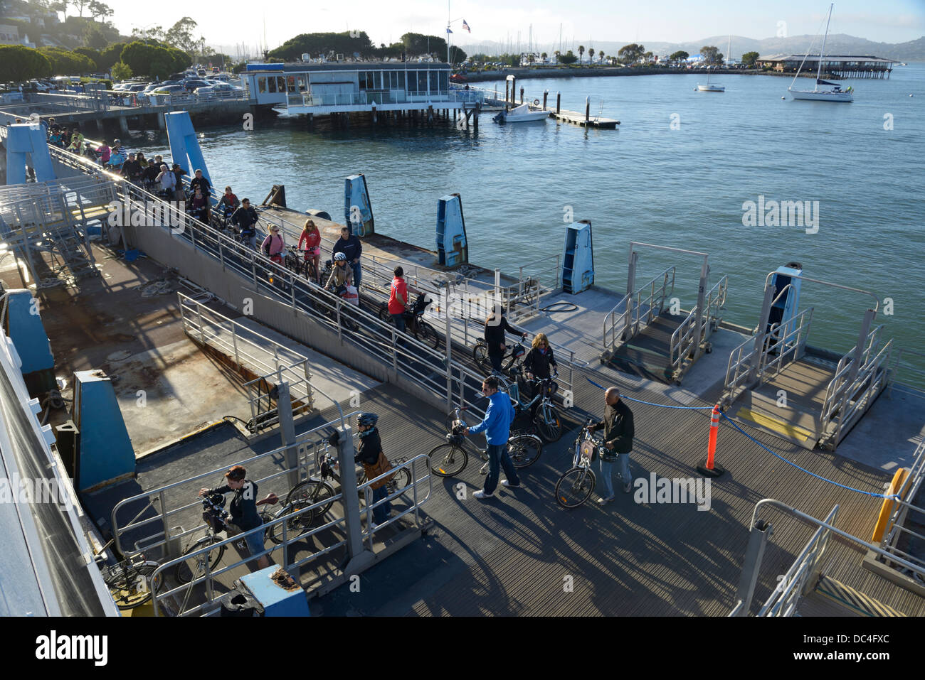 Passengers with bikes boarding ferry to SF, Sausalito, CA - Stock Image