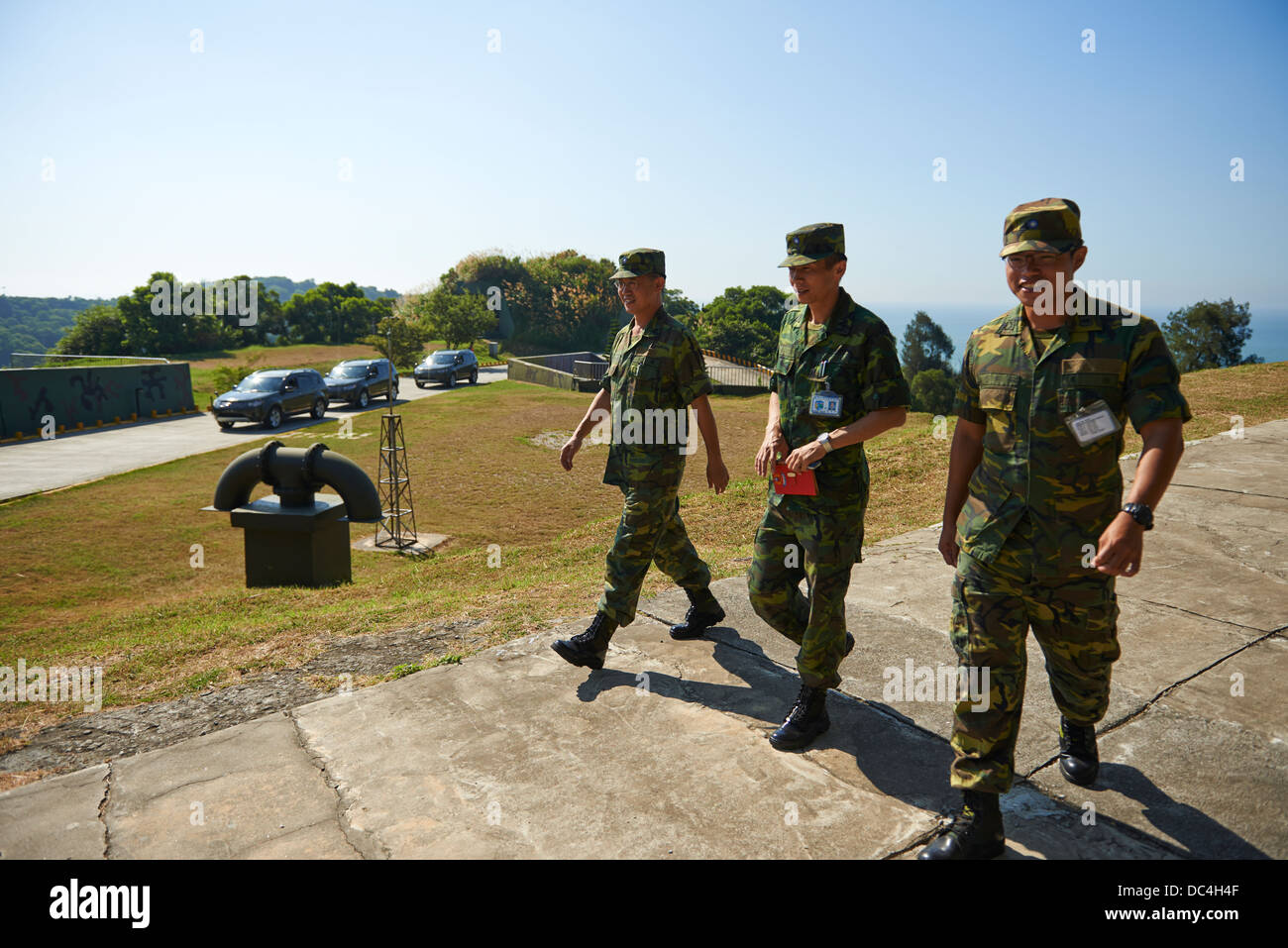 Taiwanese military soldiers walk across a Beigan Military base. - Stock Image