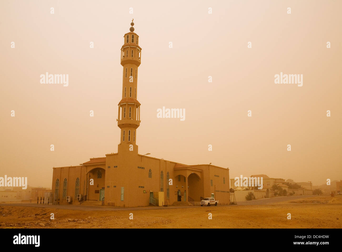 A mosque in a sandstorm in the town of Sakaka, Saudi Arabia. - Stock Image
