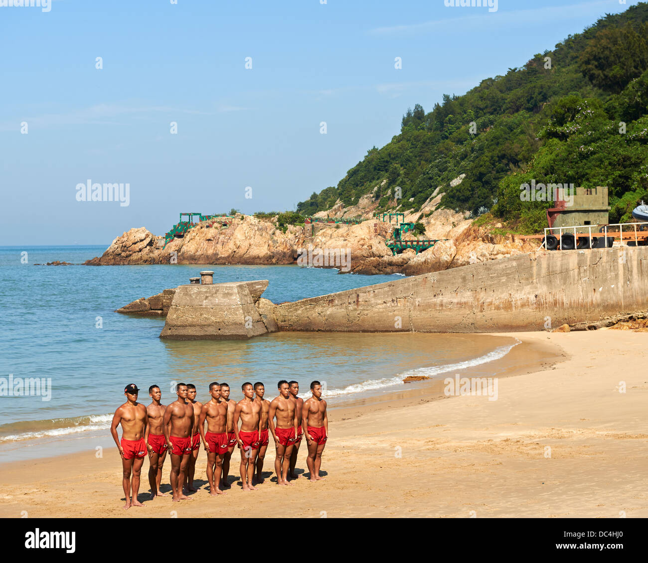 Taiwanese Navy Seals, nicknamed 'frogmen' train and do exercises to keep in shape on the beach of Nangan - Stock Image