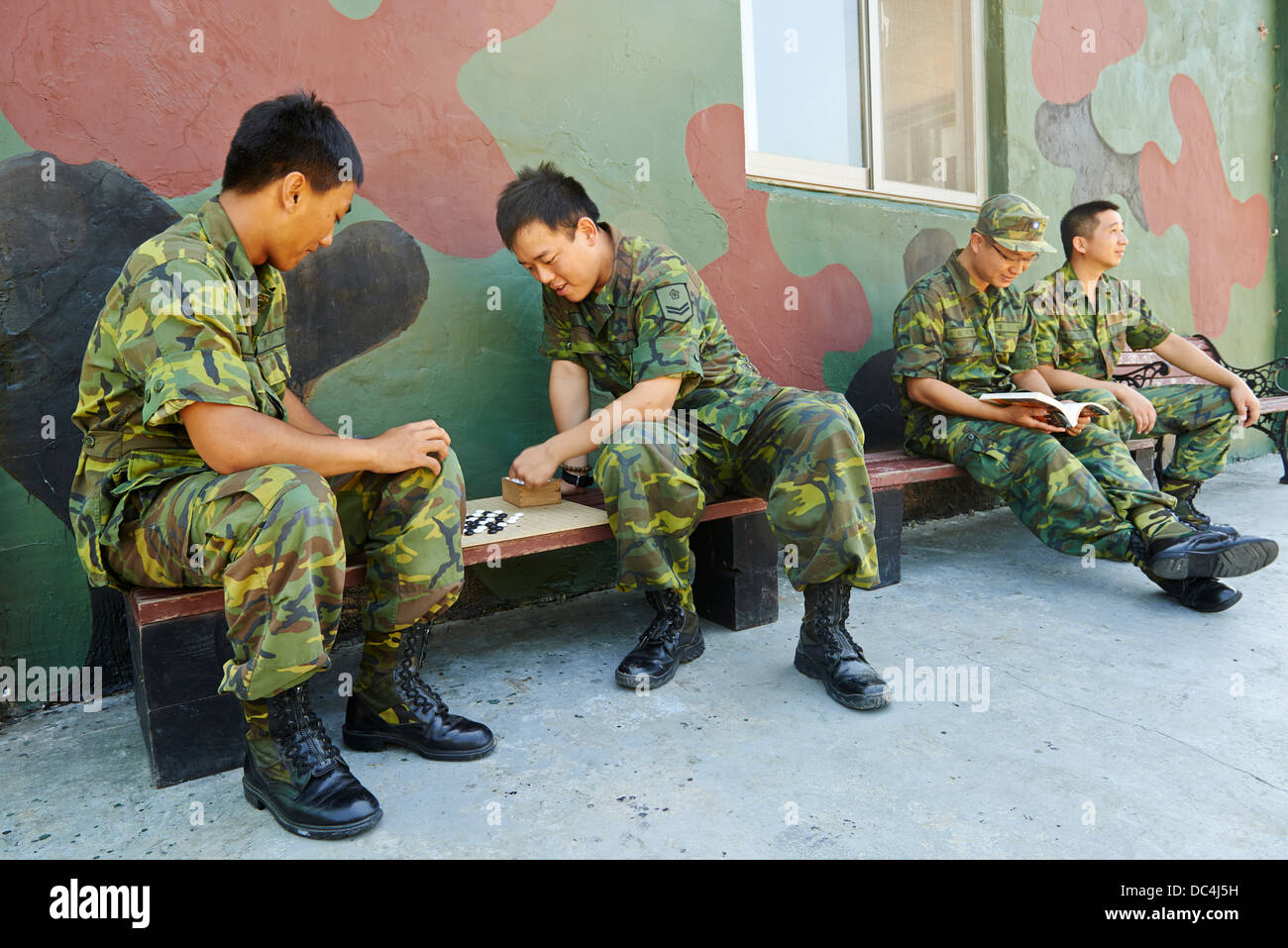 Soldiers relax while playing games and reading magazines on the island of Nangan. There remain 5,000 Taiwanese soldiers - Stock Image
