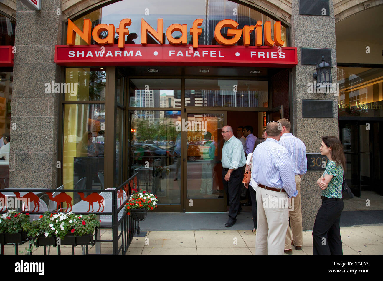 Patrons Standing In Queue Outside Naf Naf Grill Middle