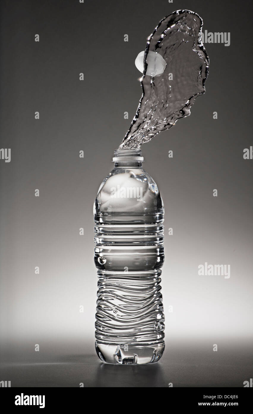 Water Bottle With Water Squirting Out - Stock Image