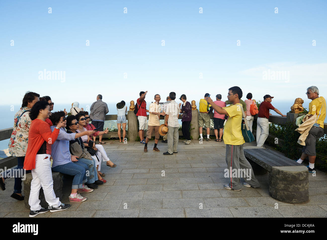 Tourists posing on the top of Mount Bi in Beigan on the Matsu Islands. - Stock Image