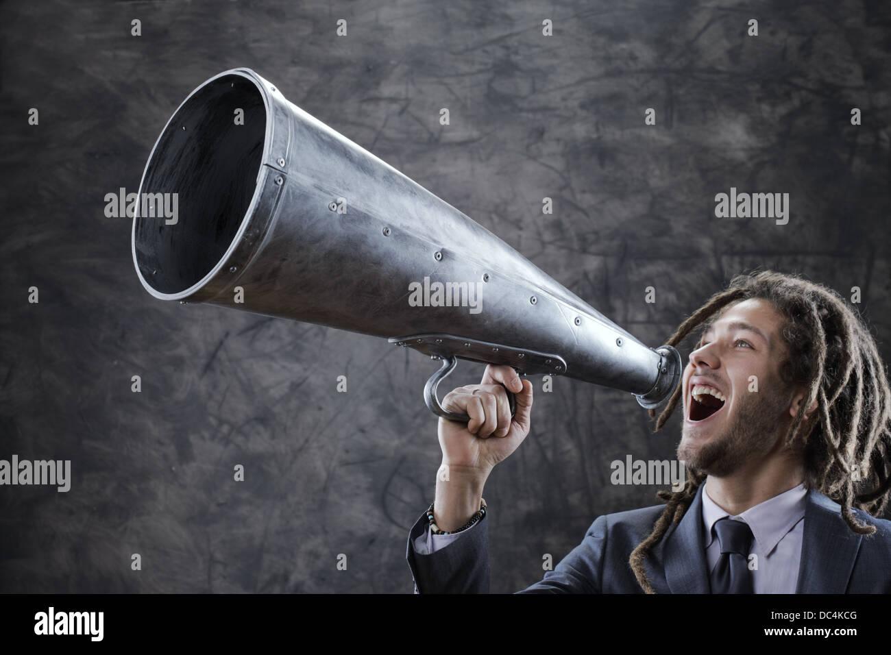 screaming into megaphone - Stock Image