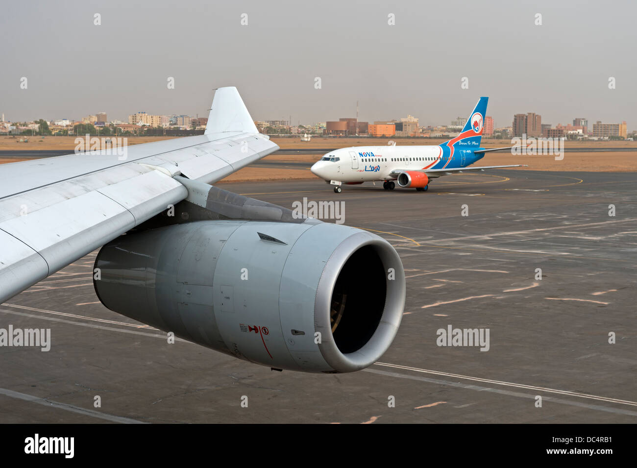 At Khartoum International Airport, engine of an Airbus 340 and a Boeing aircraft of the Sudanese Nova Airways, Khartoum, - Stock Image