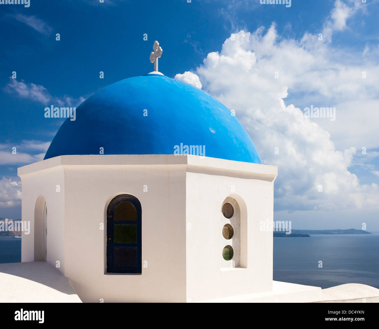 Beautiful blue domed church overlooking the Aegean Sea at Oia Santorini Greece Europe - Stock Image