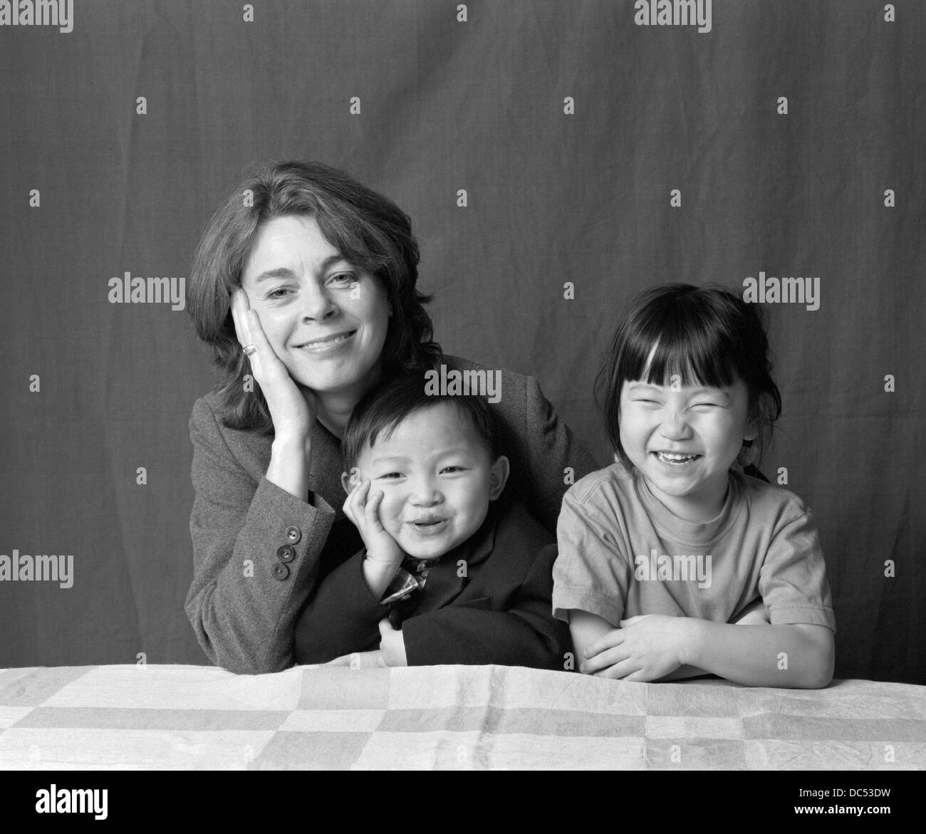 Swedish mother with chinese adopted children - Stock Image