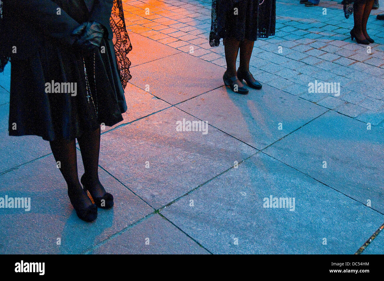 Women's legs during Holy Week procession. Madrid, Spain. Stock Photo