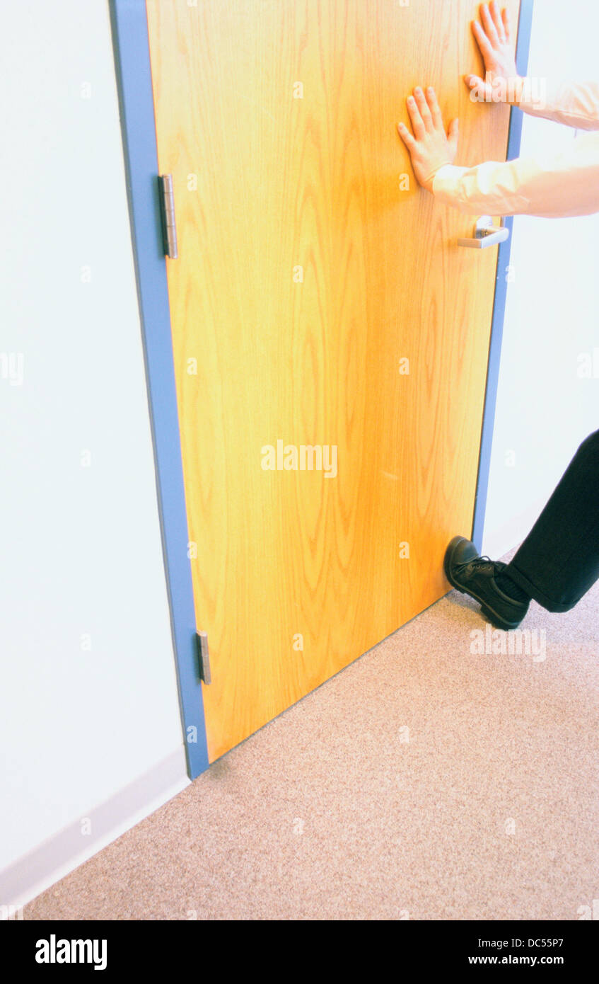 Businessman holding office door shut & Businessman holding office door shut Stock Photo: 59121279 - Alamy