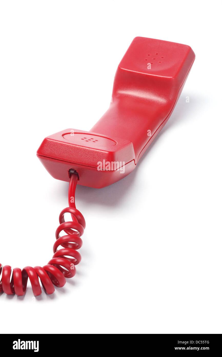 Red Telephone Handset Lying On White Background - Stock Image