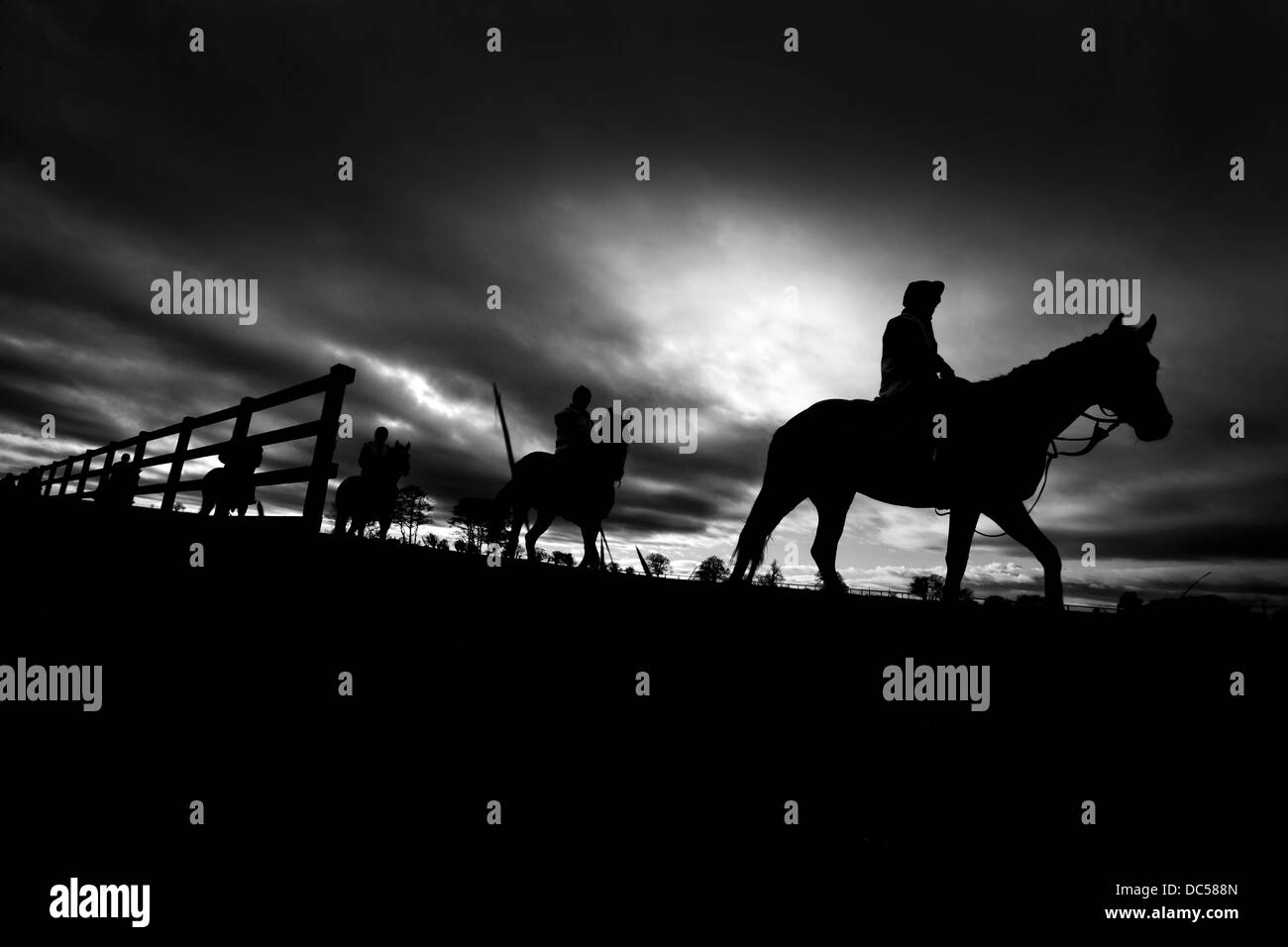 silhouette of horses and jockeys at Manor House Stables horse - Stock Image