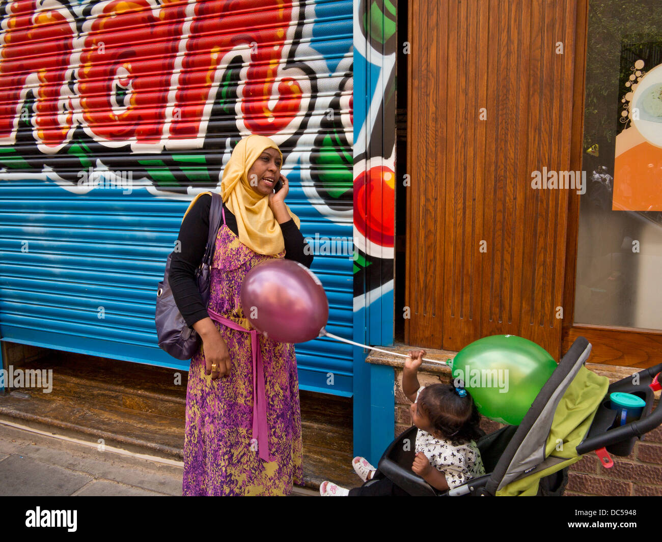 Muslim families celebrate Eid Mubarak, at the end of Ramadan, by the East London Mosque in Whitechapel. - Stock Image