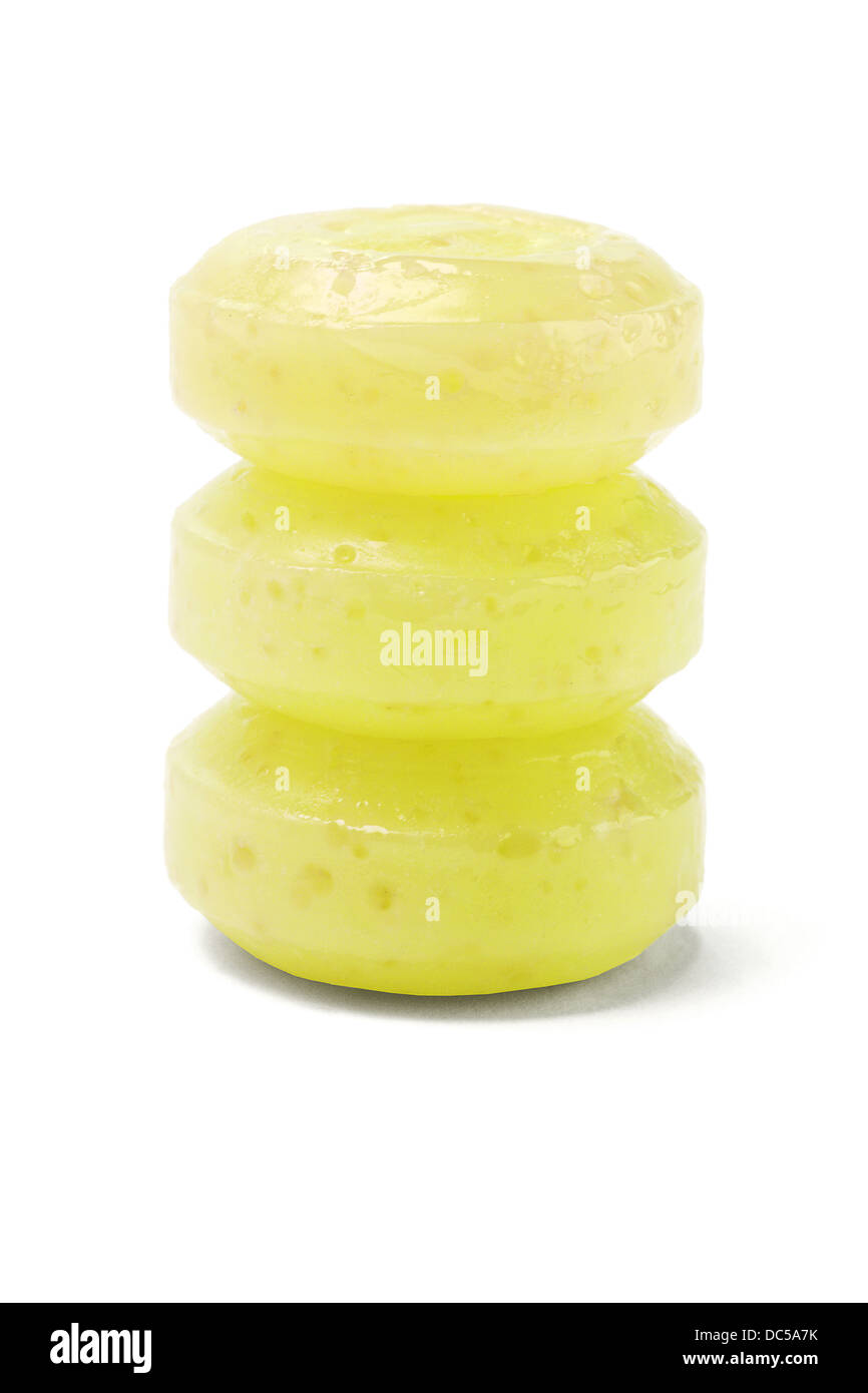 Stack Of Three Yellow Lozenges On White Background - Stock Image