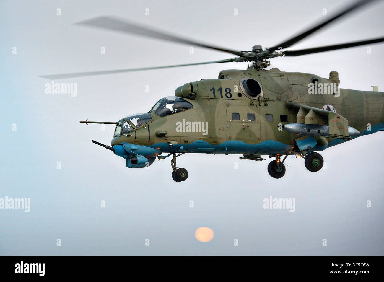 An Afghan air force Mi-35 attack helicopter departs on a mission July 23, 2013 at Jalalabad Airfield, Afghanistan. - Stock Image