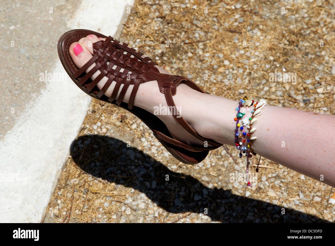 Girls sandal with ankle bracelets - Stock Image