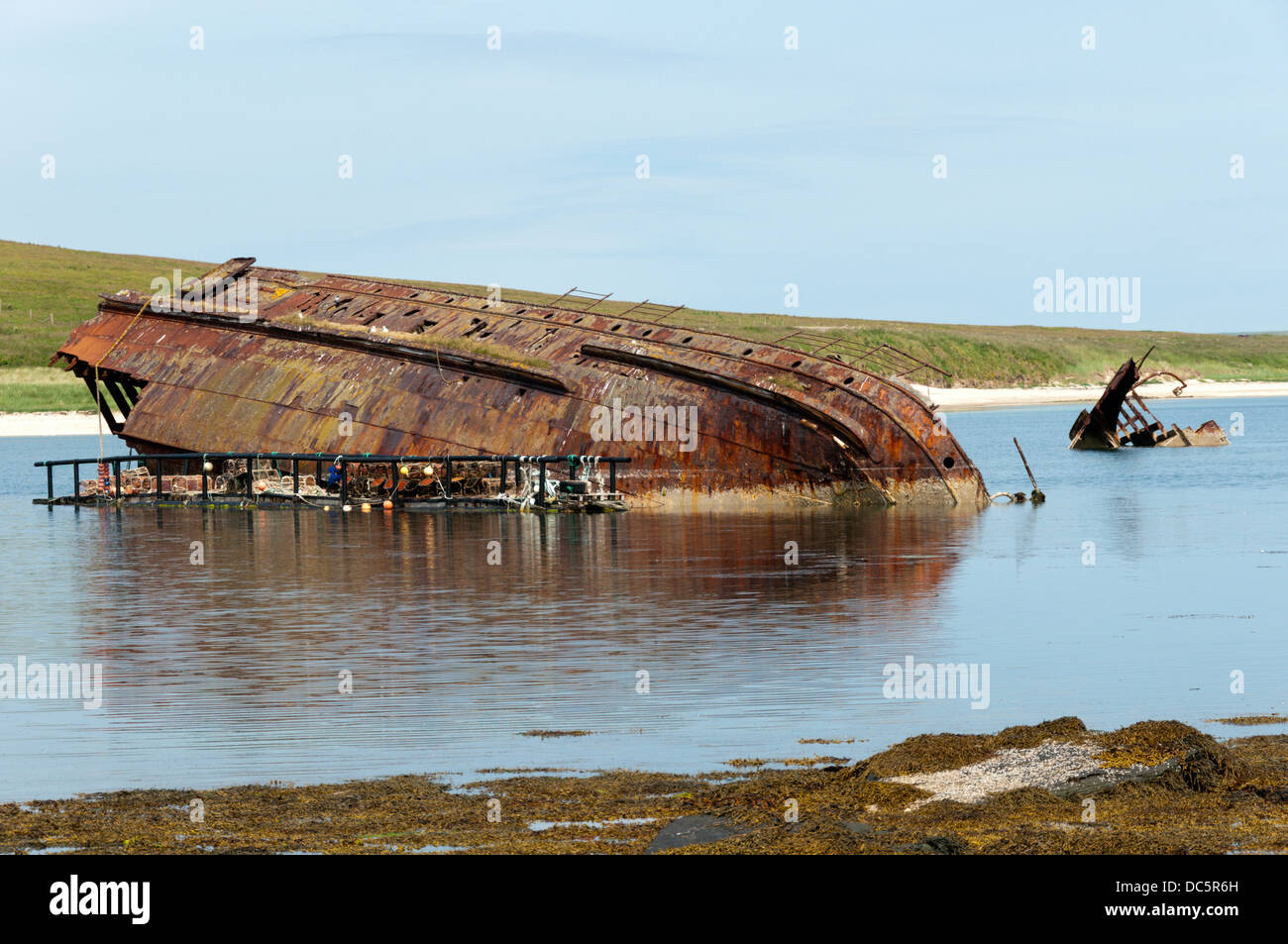 Remains of a blockship in eastern Weddell Sound next to Churchill Barrier 3 between Glimps Holm and Burray, Orkney. Stock Photo