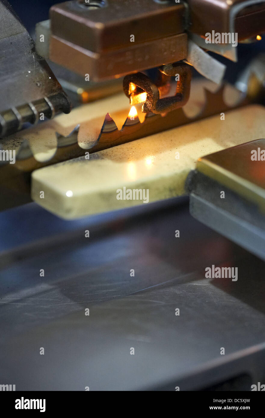 Induction heat treatment, saws manufacturing, hand tool, metallurgy - Stock Image