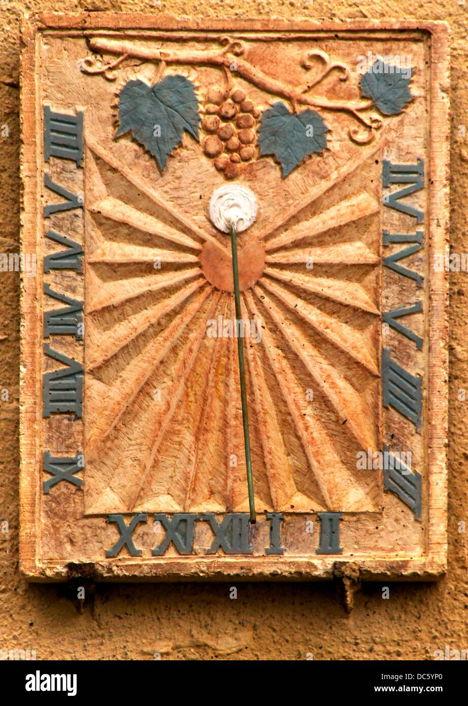 Sun clock with a wine grape motif, at Manciet, Gers, Midi-Pyrenees, France - Stock Image