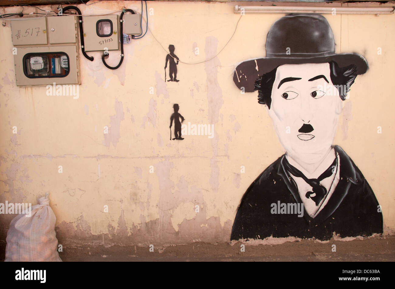 Bolivia June 2013. La Paz. Charlie Chaplin wall painting next to electric meter. - Stock Image