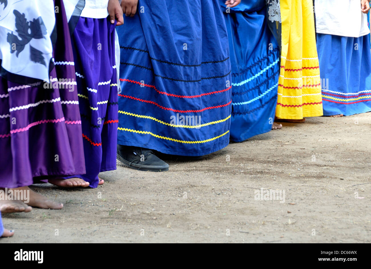 Dresses of young women dancers of the Salt River Maricopa-Pima tribes demonstrating a dance - Stock Image