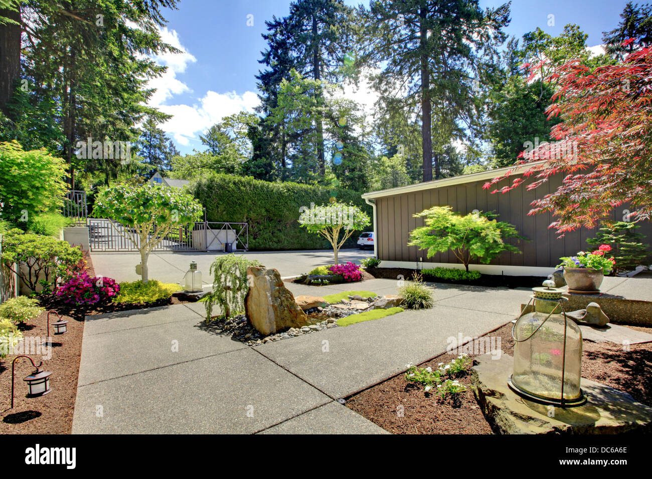 Modern Front Yard Landscape With Walkways And Rocks Stock Photo