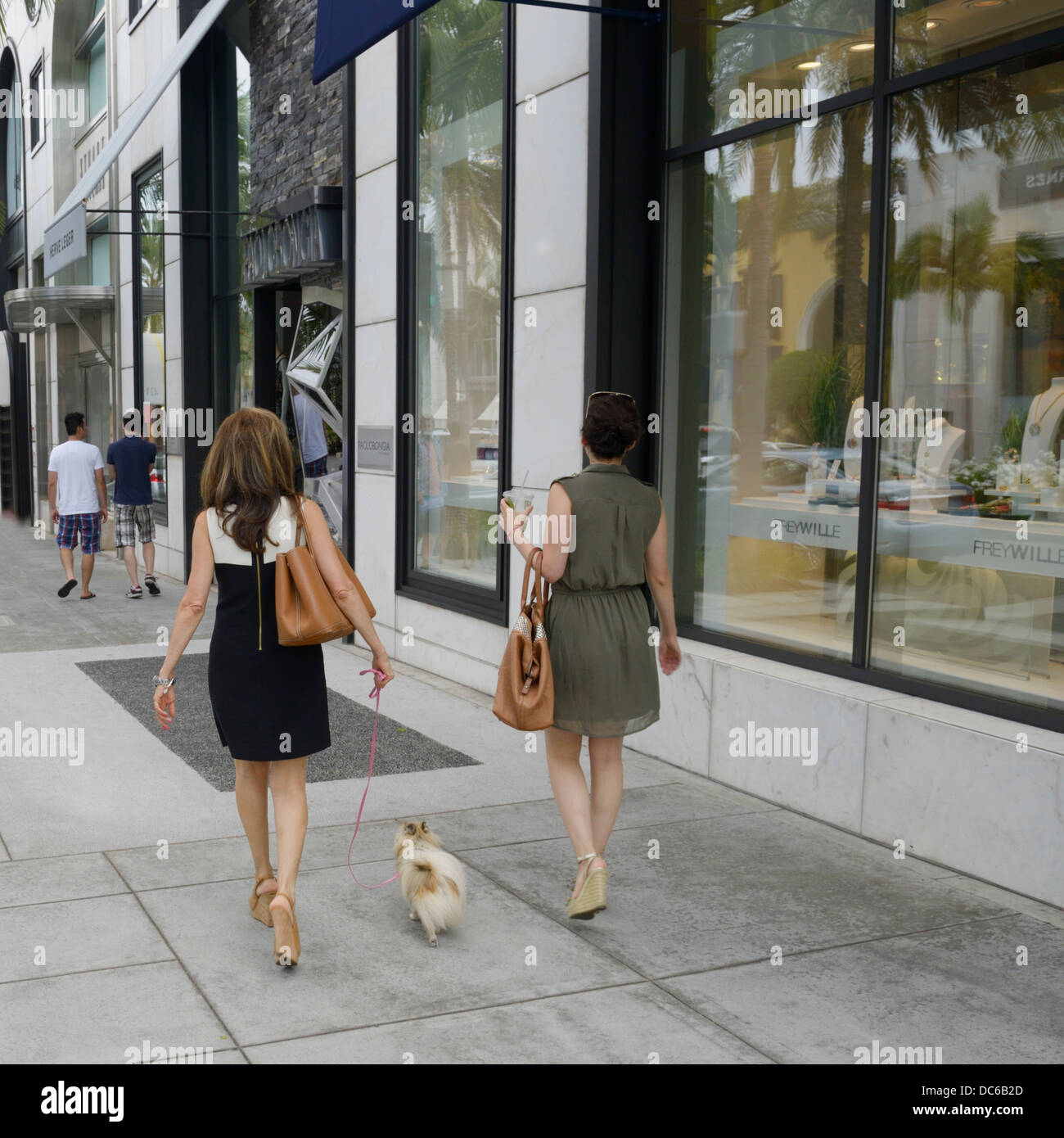 Women and their pet shopping, Rodeo Drive, Beverly Hills, CA Stock Photo