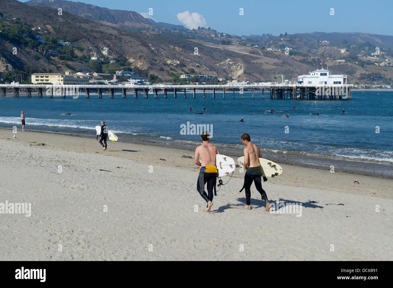 Men walking with surfboards, Surfrider Beach, Malibu, CA Stock Photo