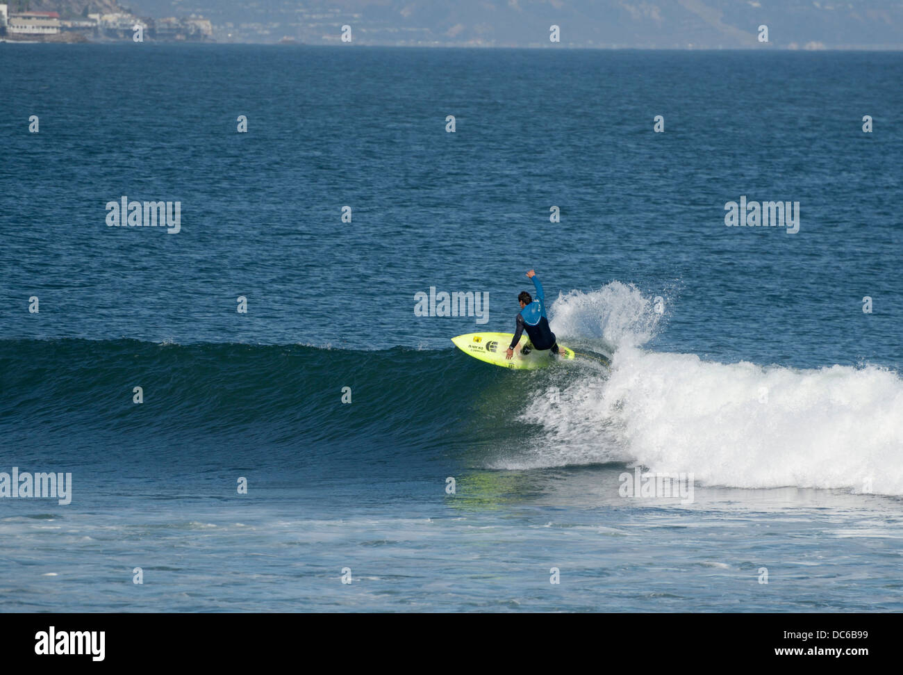 Lone surfer riding a wave, Surfrider Beach, Malibu, CA - Stock Image