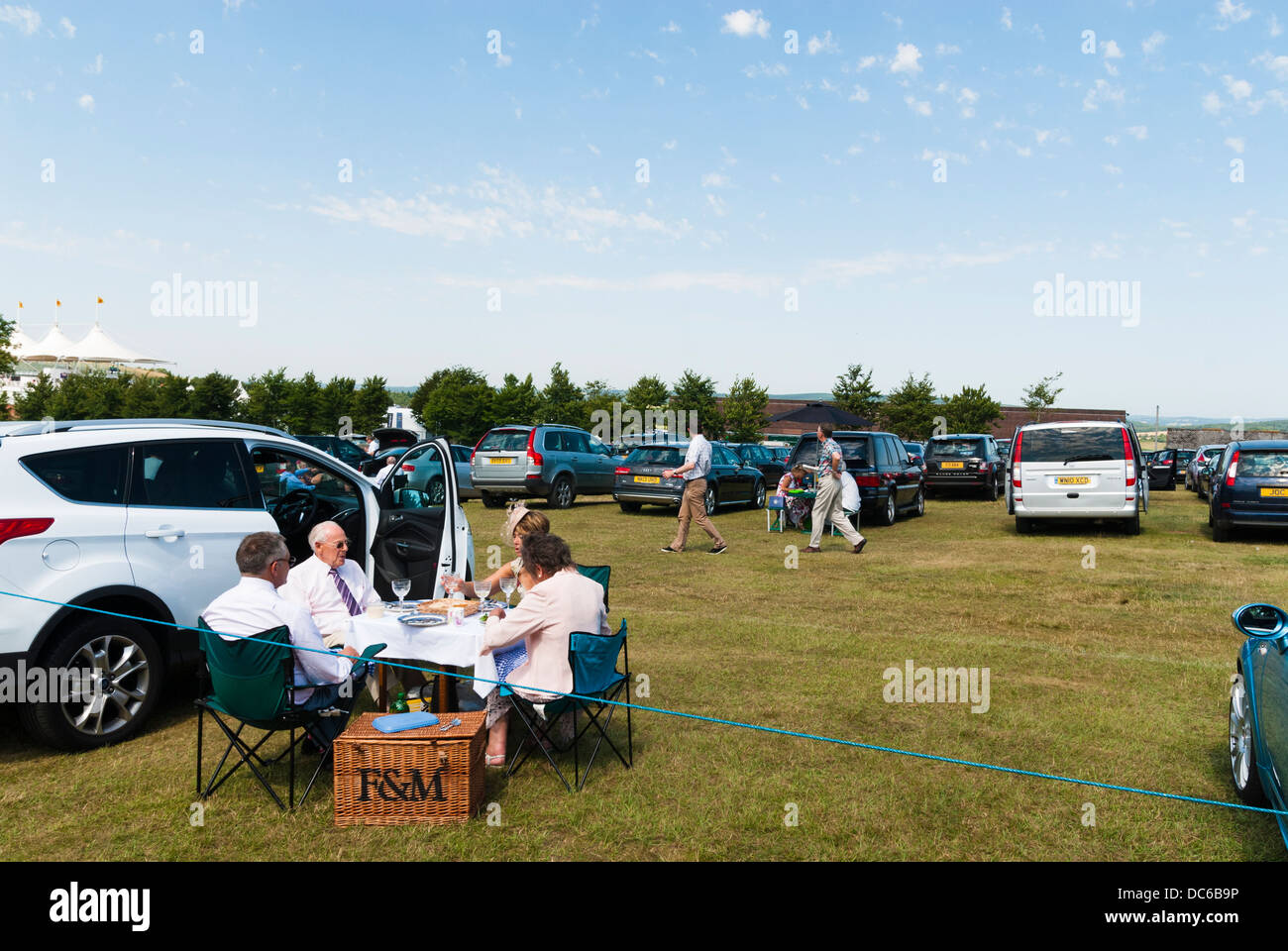 Picnicking in the car park with a Fortnum and Mason Hamper Stock Photo