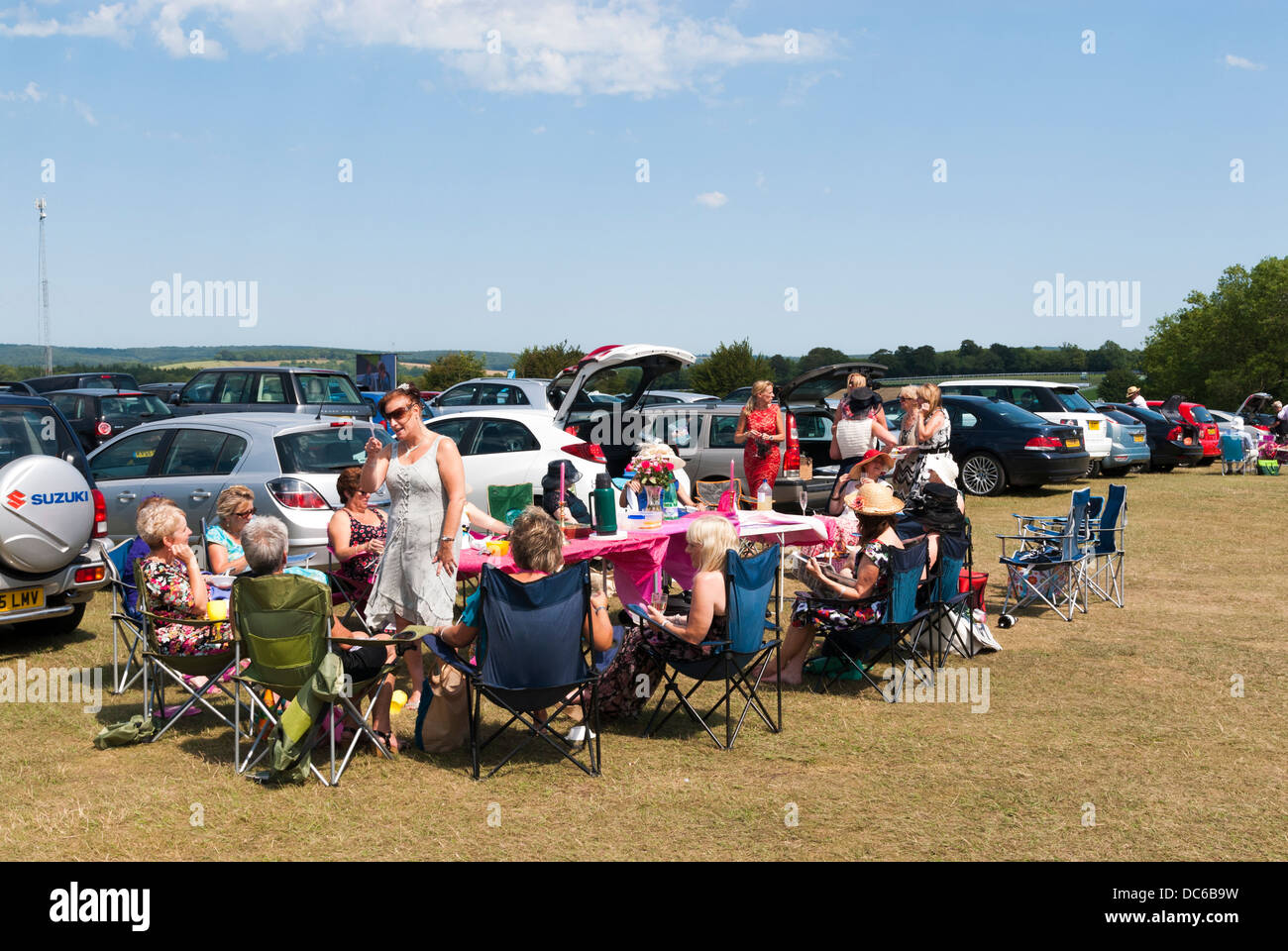 Ladies picnicking in the car park before racing at Goodwood - Stock Image