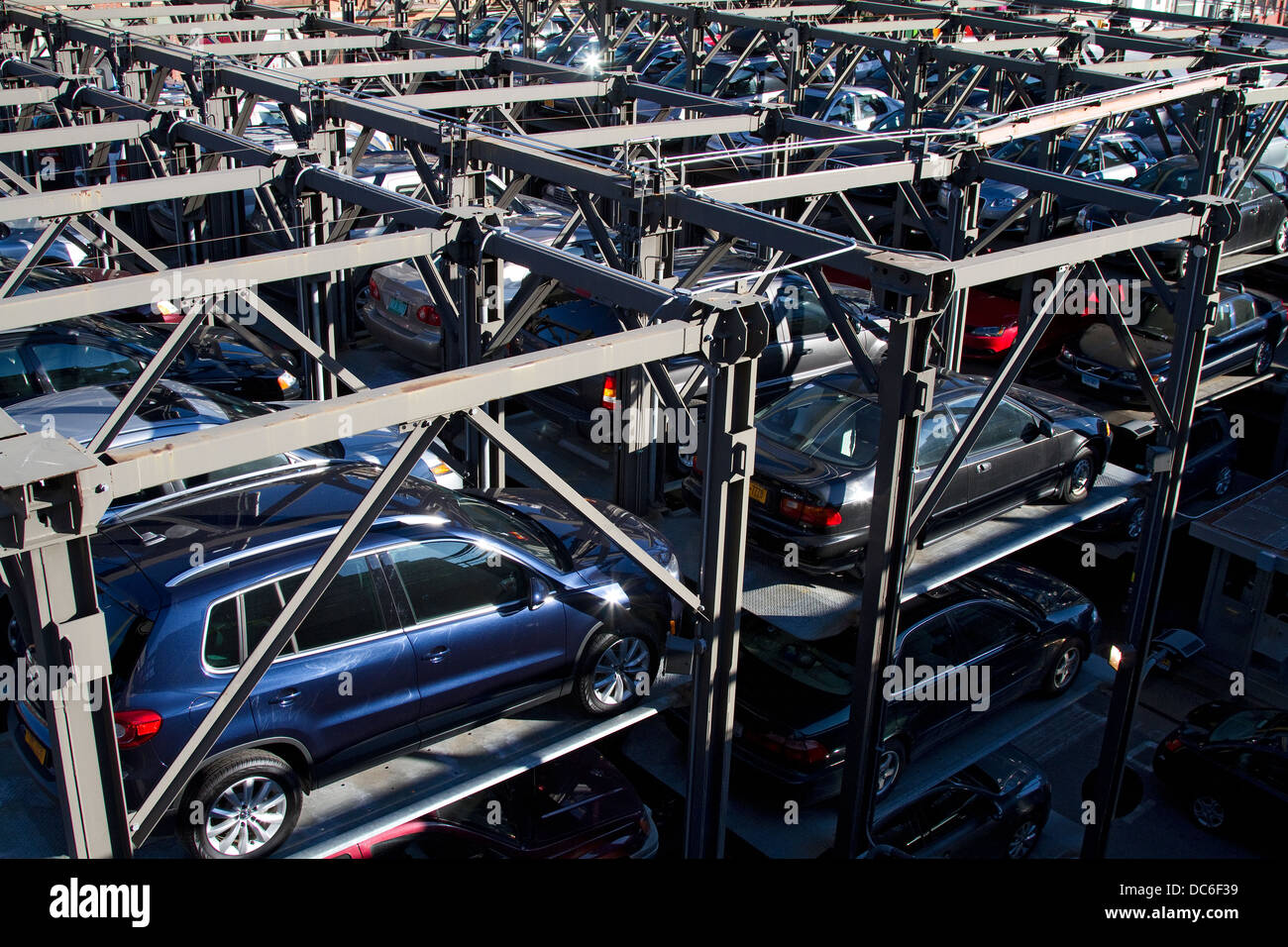 New York carpark, elevated parking garage with stacked cars. - Stock Image
