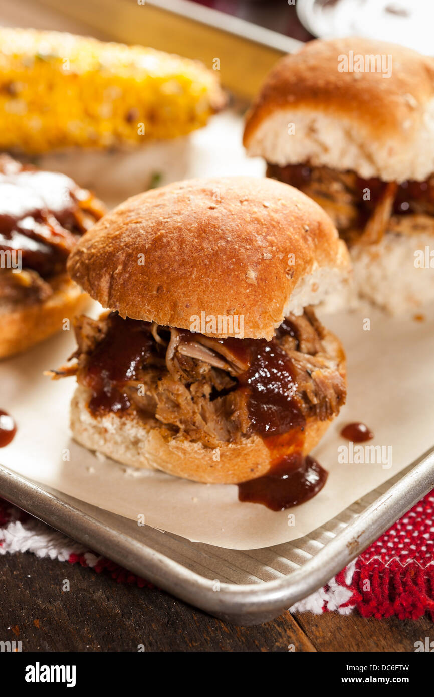 Smoked Barbecue Pulled Pork Sliders with Sauce - Stock Image