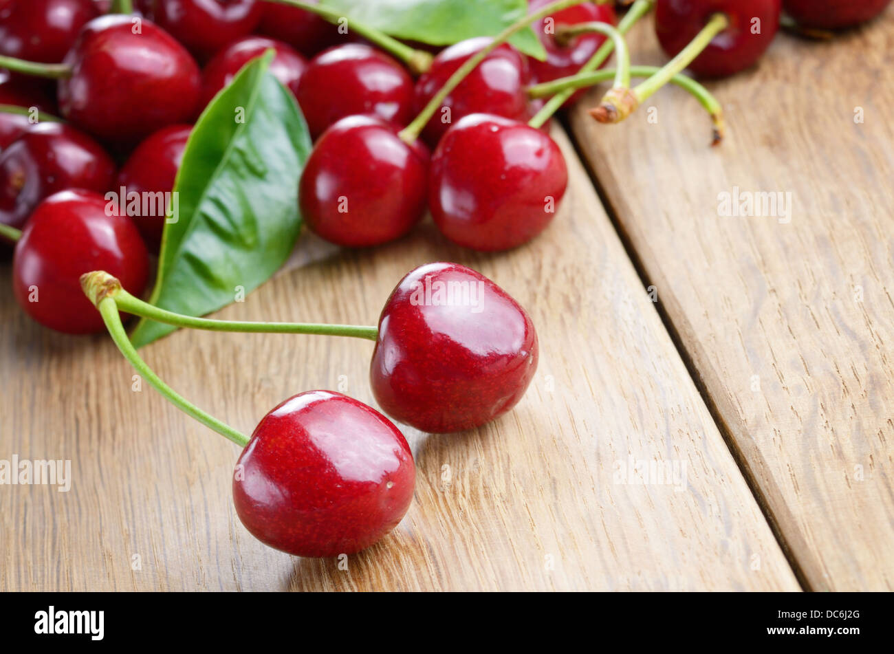 Organic Cherries on the wooden table closeup - Stock Image