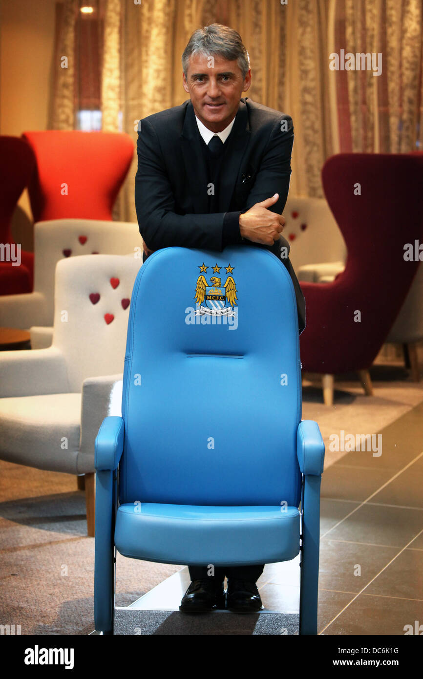Roberto Mancini with Manchester City Football Club chair - Stock Image