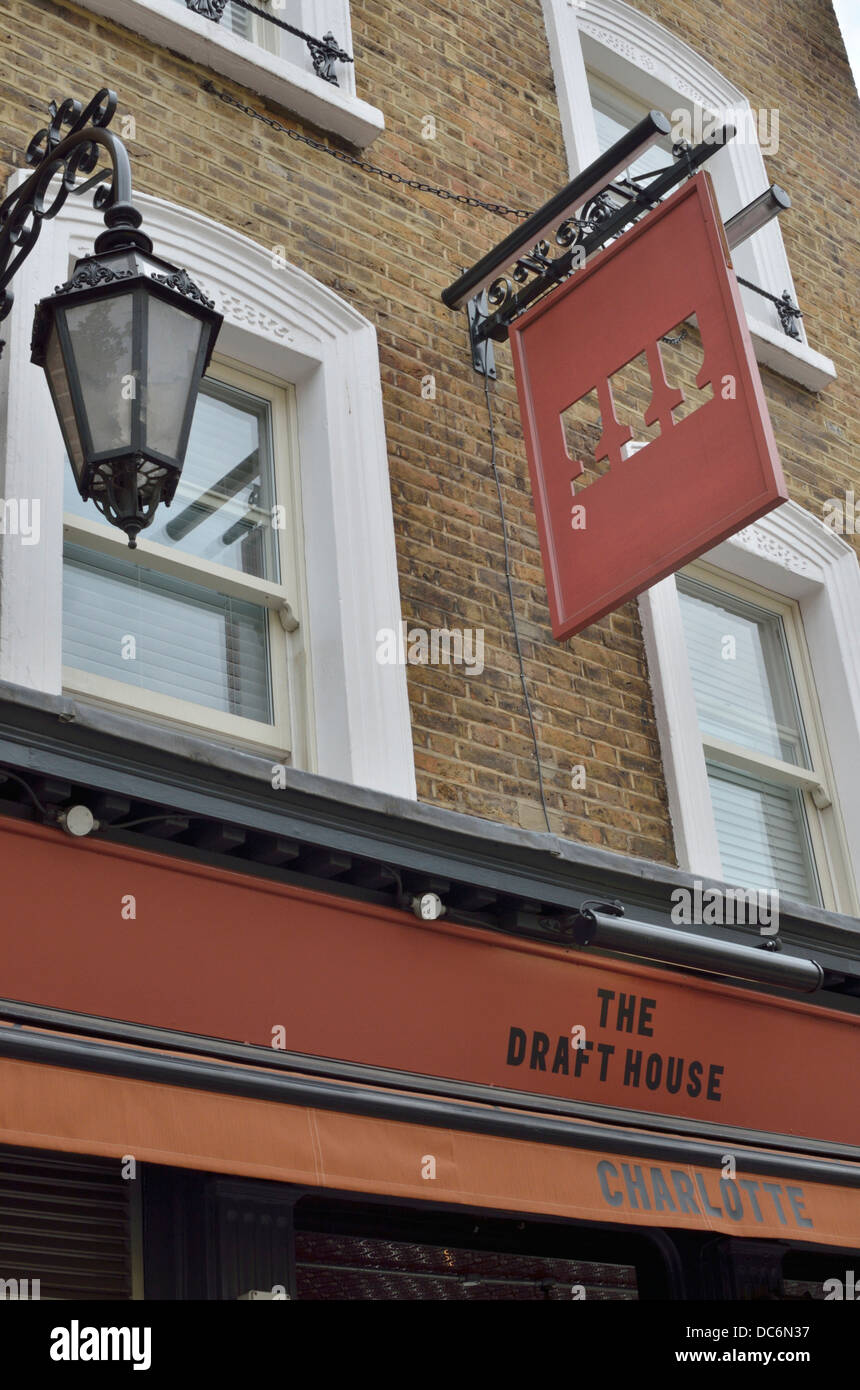 The Draft House pub bar in Charlotte Street, Fitzrovia, London, UK. - Stock Image
