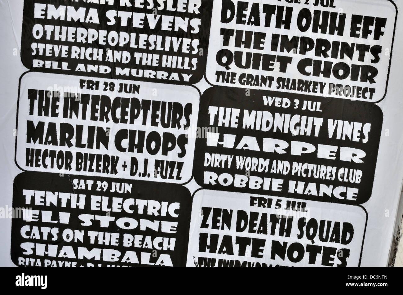 Advertisements for live bands outside a small London UK music venue - Stock Image