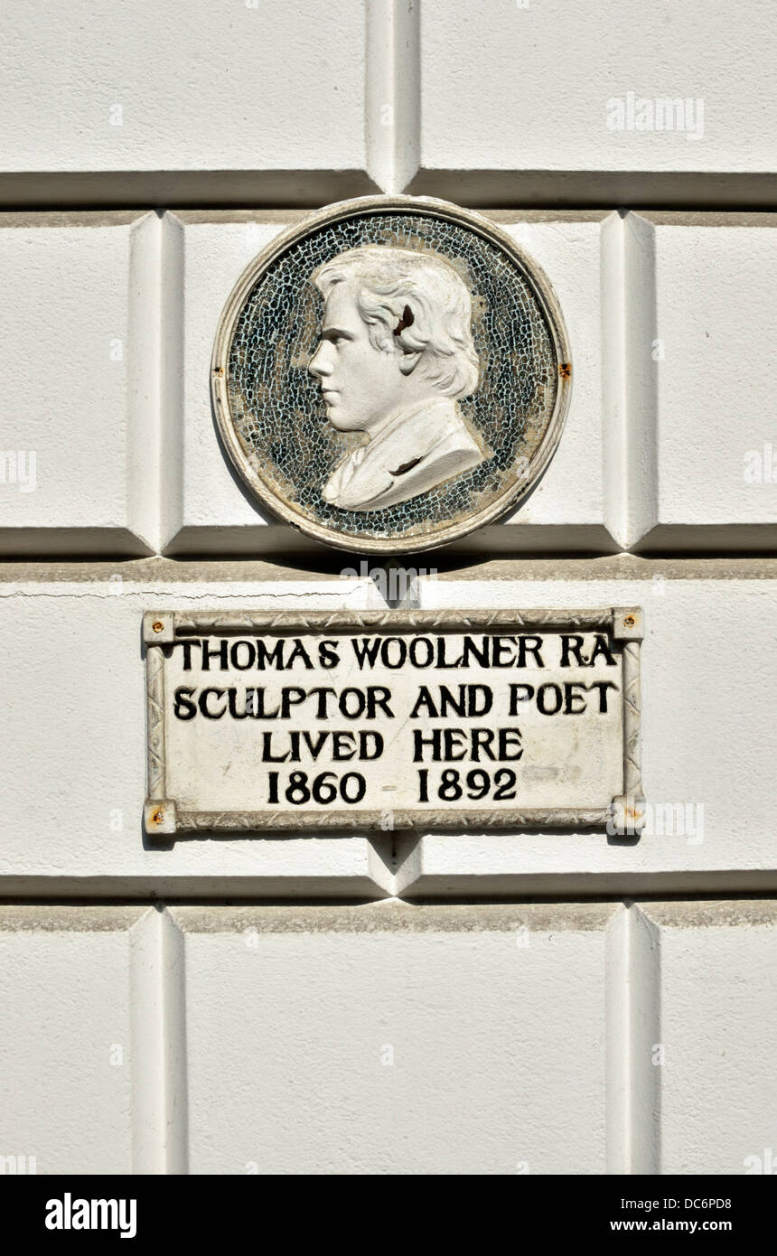 Thomas Woolner Ra memorial plaque outside his former home in Welbeck Street, Marylebone, London, UK. - Stock Image
