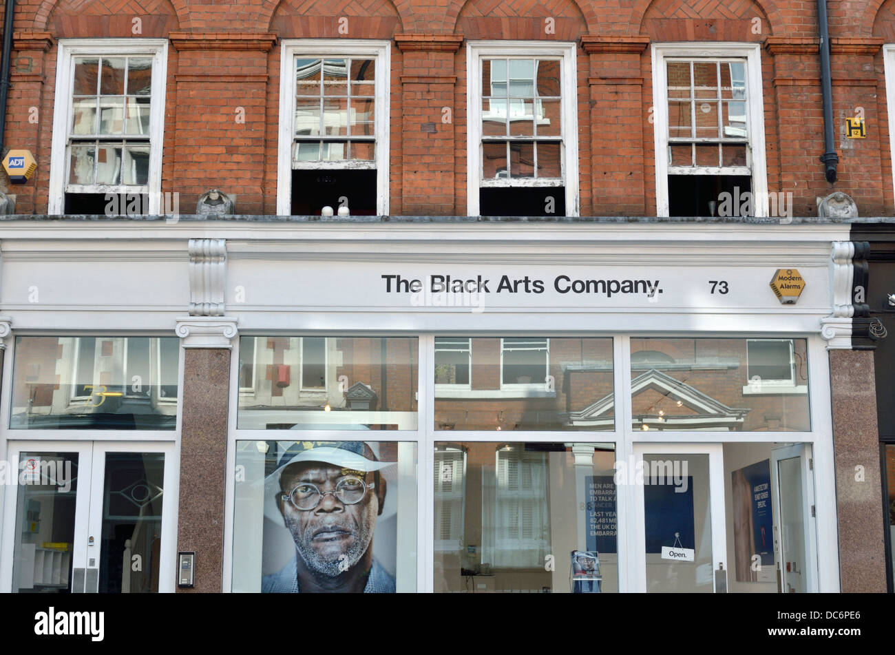 The Black Arts Company advertising organisation HQ in Great Titchfield Street, Fitzrovia, London, UK. - Stock Image
