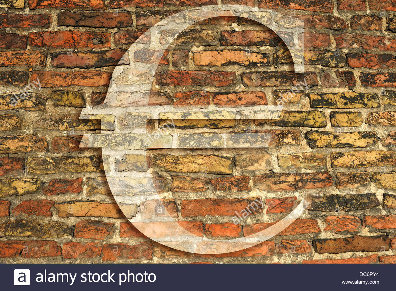Digital composite Ancient brick wall with Euro symbols - Stock Image