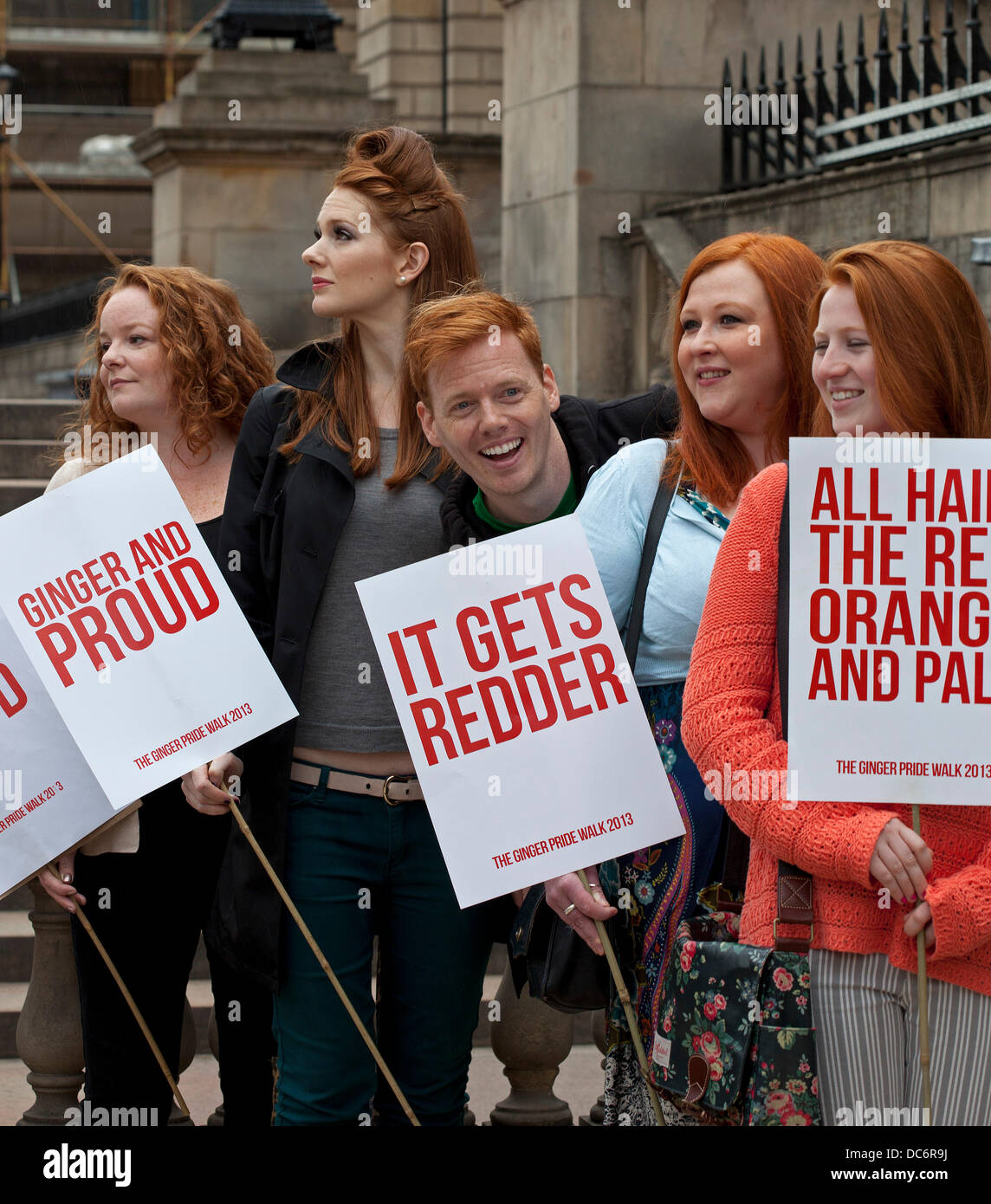 Edinburgh,UK. 10th August 2013. A red-haired comedian leads a march across Edinburgh in the name of Ginger pride. - Stock Image