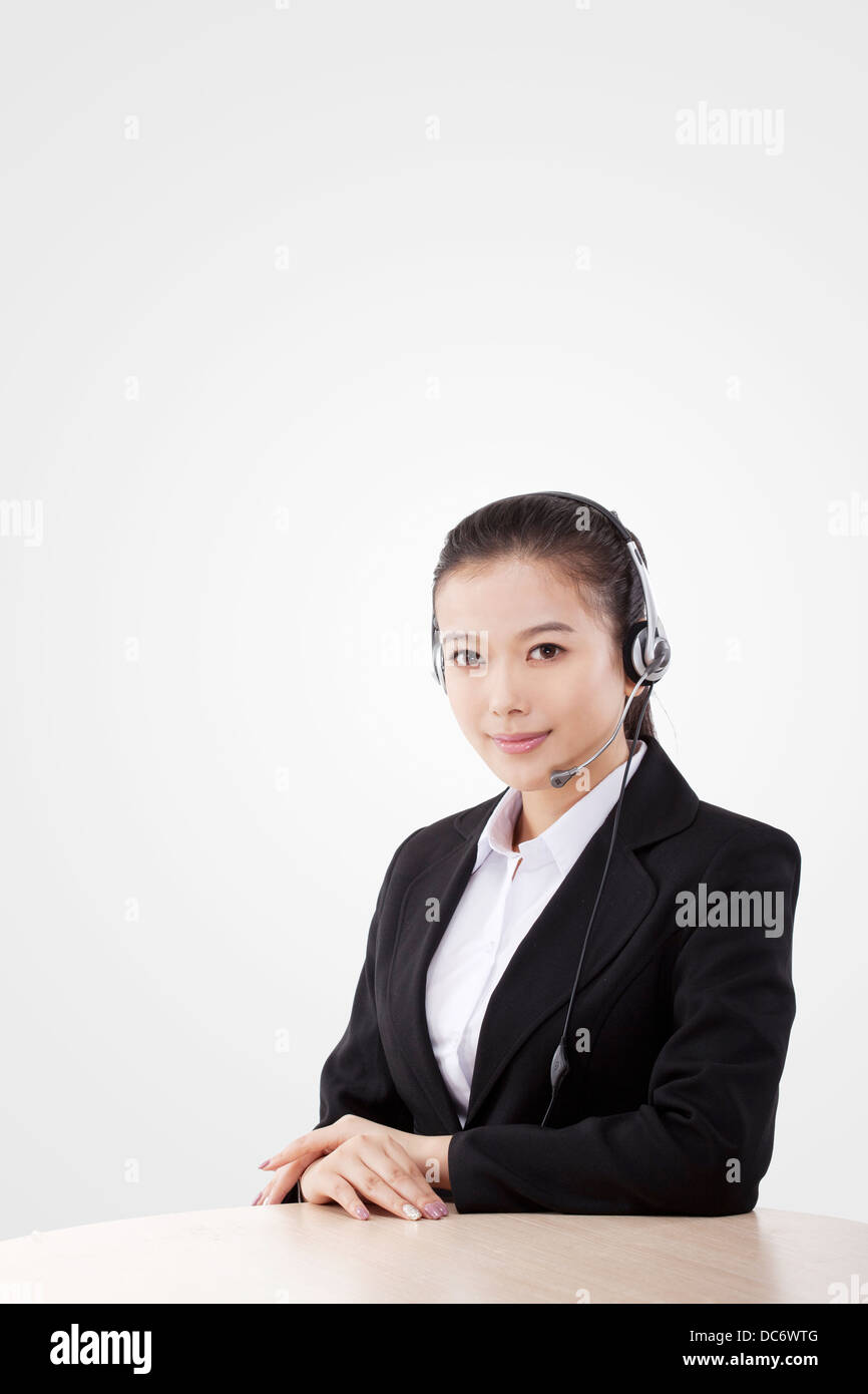Oriental business lady wearing headset Stock Photo