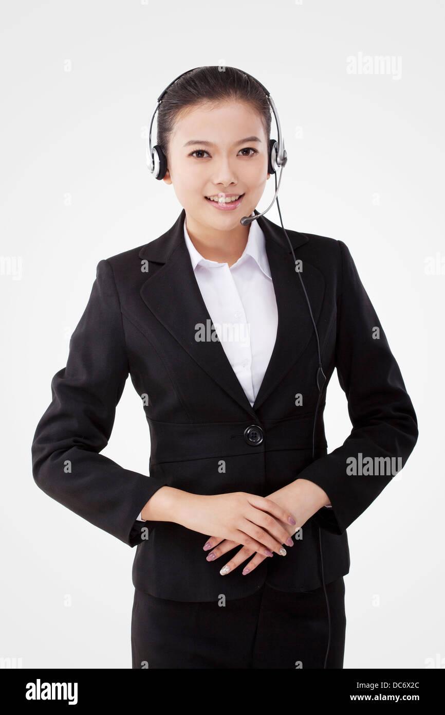 Oriental business lady wearing headset Stock Photo
